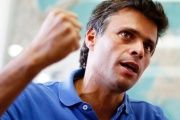 Leopoldo Lopez was sentenced to a 14-year prison sentence for charges including public promotion of violence, property damages, arson and crime association.