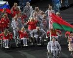 Paralympians of Belarus carry the Russian flag in protest.