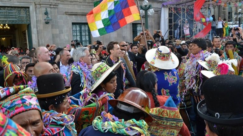 President Evo Morales, Vice President Alvaro Garcia, and actor Jude Law are surrounded by carnival performers, La Paz, Feb. 13, 2015.