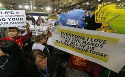 People attend a demonstration inside the World Climate Change Conference 2015 (COP21) Dec. 9, 2015