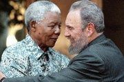 Nelson Mandela and Fidel Castro embrace.