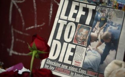 A picture of Eric Garner is seen on a newspaper at his memorial in Staten Island, New York, July 21, 2014. Garner, suspected of selling untaxed cigarettes, died after New York police put him in a chokehold. The cause of Garner's death is still being determined by the city's medical examiner. REUTERS/Eduardo Munoz