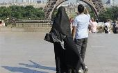 Veiled woman in Paris.