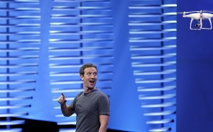 Facebook CEO Mark Zuckerberg looks at a flying drone on stage during the Facebook F8 conference.