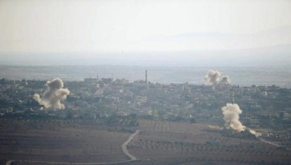 Smoke rises from explosions during fighting in the village of Jubata Al Khasab in Syria, as seen from the Israeli side of the border fence between Syria and the Israeli-occupied Syrian Golan.