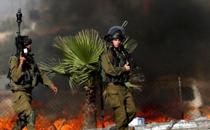 Israeli soldiers are seen during clashes with Palestinian protesters in the West Bank town of Al-Ram, near Jerusalem, Oct. 9, 2016.