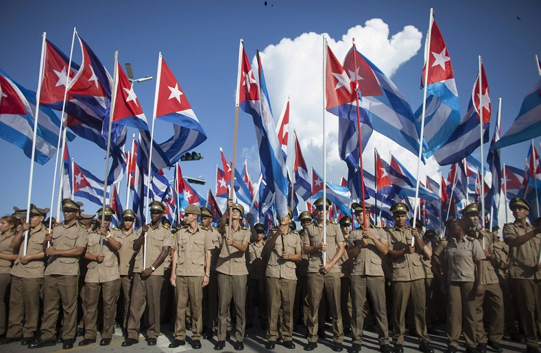 Soldiers wave the Cuban flag during Cuban Revolution commemorations in recent years.