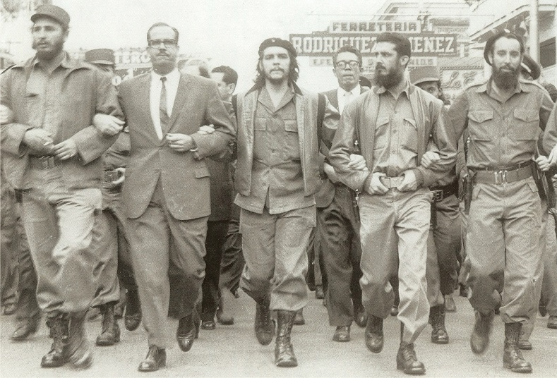 Fidel Castro (far left) and Che Guevara (center) lead a memorial march in Havana on May 5, 1960, for the victims of the La Coubre freight ship explosion, considered to be one of the first CIA attempts to undermine the Cuban Revolution.