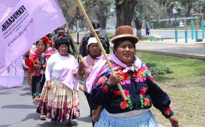 The march included women of various ages all wearing traditional clothing from their regions