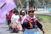 The march included women of various ages all wearing traditional clothing from their regions.