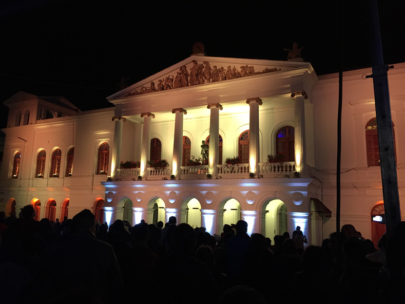 The colors of the Sucre National Theatre alternated while lights danced across the walls to a musical accompaniment.
