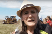 Amy Goodman shown during her coverage of the incident for which she has been charged for trespassing.
