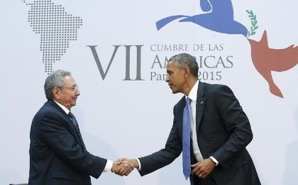 U.S. President Barack Obama shakes hands with Cuba's President Raul Castro as they hold a bilateral meeting during the Summit of the Americas in Panama City April 11, 2015.