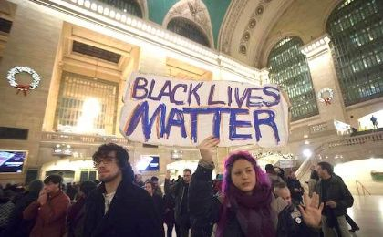 Demonstrators protest to demand justice for the death of Eric Garner, at Grand Central Terminal in the Manhattan borough of New York