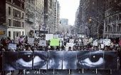 Protesters held up 8 panels depicting Eric Garner's eyes, created by an artist known as JR.