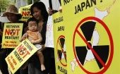 A mother and child join a protest against the Japanese government's decision to restart two nuclear reactors in 2012. (Photo. Reuters)