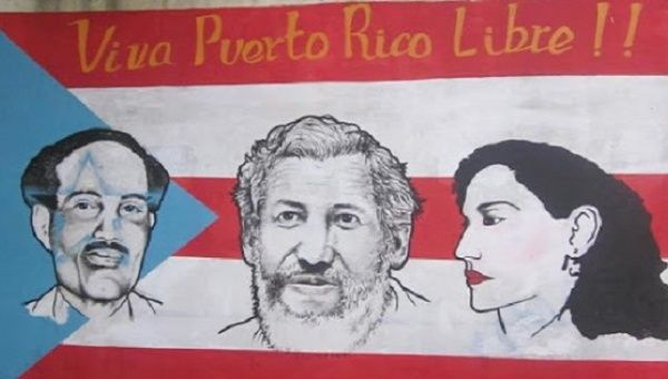 The Puerto Rican flag with the likenesses of independence leaders Don Pedro Albizu Campos, Filiberto Ojeda Rios and Lolita Lebron.