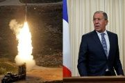 As the Russian Defense Ministry threatened to down U.S. warplanes, Russian Foreign Minister Lavrov (R) was busy conducting diplomacy with France.