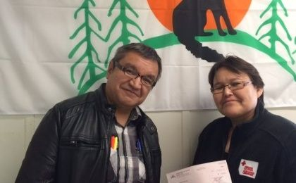 Attawapiskat Chief presents a US$5,000 donation to support Alberta fire relief.
