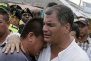 Ecuadorean President Rafael Correa embraces a resident in the town of Canoa, April 18, 2016.