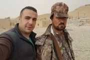 Shadi Halwi (L) poses with Suheil al Hassan, a major general in the Syrian Army, in Palmyra.