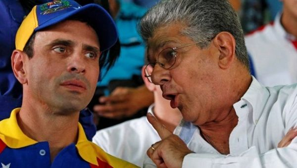 Opposition leader Henrique Capriles (L) during an anti-government rally with Henry Ramos Allup, Sept. 26, 2016.