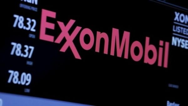 The logo of Exxon Mobil Corporation is shown on a monitor above the floor of the New York Stock Exchange in New York, Dec. 30, 2015.