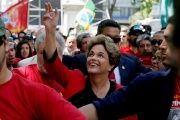 Former Brazilian President Dilma Rousseff is saluted by people after giving her speech in a rally organised by Uruguay's workers union PIT-CNT in Montevideo, Uruguay November 4, 2016.