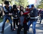 Police detain activist Sebahat Tuncel during a protest against the arrest of Kurdish lawmakers, in the southeastern city of Diyarbakir, Turkey, Nov. 4, 2016.
