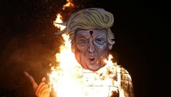 An effigy of U.S. Republican presidential candidate Trump is burnt as ...