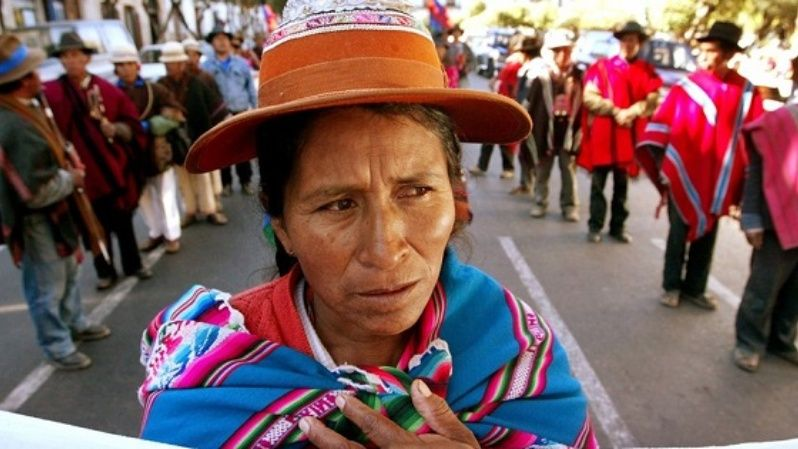 An Indigenous woman joins a demonstration calling for the protection of Mother Earth in Bolivia.