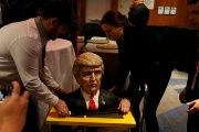 A cake in the form of Republican U.S. presidential nominee Donald Trump is brought into the hotel where his election night rally will be held in Manhattan, New York.