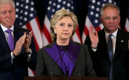 Hillary Clinton, accompanied by Bill Clinton and running mate Tim Kaine, speaks about the results of the U.S. election at a hotel in New York, Nov. 9, 2016.