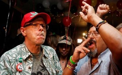 William Britt (L) and Al Moreno (R) celebrate after Californians voted to pass Prop 64, legalizing recreational use of marijuana in the state, in Los Angeles, California, U.S. Nov. 8, 2016.
