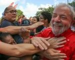 Former Brazilian President Lula da Silva is mobbed by supporters in an undated archive image.