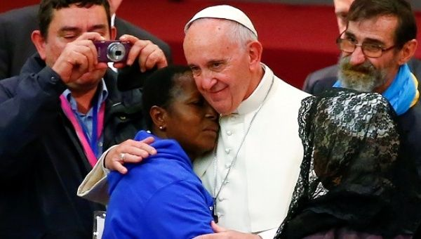 Pope Francis embraces a woman during a Jubilee audience with people socially excluded in Paul VI hall at the Vatican November 11, 2016.