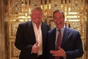 Farage poses with Trump.