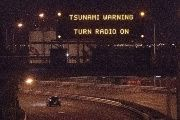 A tsunami warning alert above a highway in Wellington early on November 14, 2016.