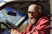 Photo posted online shows an angry man screaming at water protectors, driving through the crowds while firing gunshots.