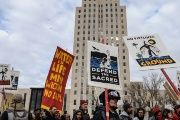 People march past the North Dakota State Capitol building during a protest in Bismarck against plans to pass the Dakota Access pipeline.