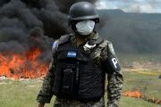 Anti-narcotics and military police officers incinerate more than 200 kilos of cocaine seized in southern Honduras, on the outskirts of Tegucigalpa, Aug. 5, 2016.