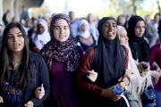 Students chant while marching at a rally against Islamophobia at San Diego State University.