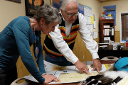 Blackfeet Nation Chairman Harry Barnes and Interior Secretary Sally Jewell review a map of the Blackfeet reservation.