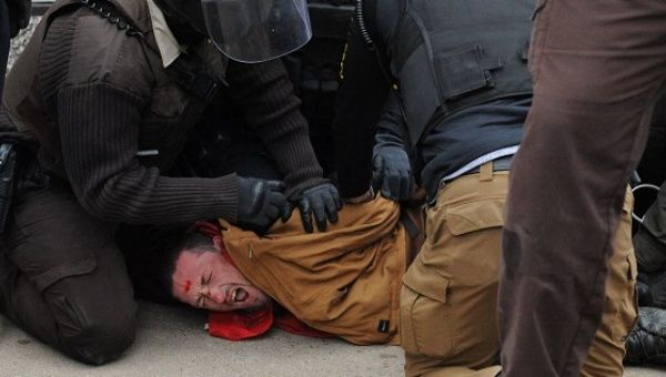 A protester is detained by police in Bismarck during a protest against plans to pass the Dakota Access pipeline near the Standing Rock Indian Reservation.