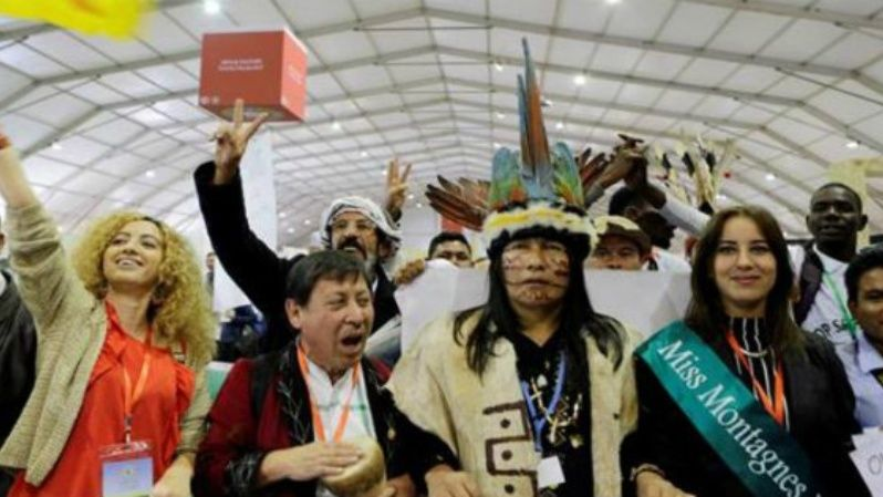 Indigenous people from different countries stage a protest during the UN Climate Change Conference in Marrakech.