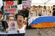 Dictator Marcos Is Buried, but Filipino People's Rage Lives On