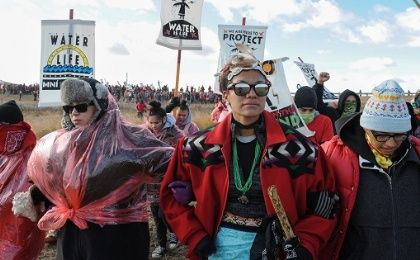 Demonstrators march against the Dakota Access pipeline near the Standing Rock Indian Reservation, near Cannon Ball, North Dakota, Nov. 18, 2016.