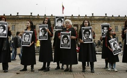 A group of women take part in a demonstration against enforced disappearance and in support of the victims in the Plaza Bolivar, Bogota, Colombia, May 29, 2009.