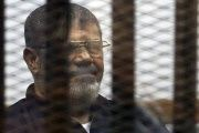 Deposed Egyptian President Mohamed Mursi listens to his verdict behind bars at a court on the outskirts of Cairo, Egypt, June 16, 2015.