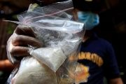 A member of the Philippine National Police shows methamphetamine, known locally as Shabu, Quiapo city, metro Manila, Philippines July 3. 2016.